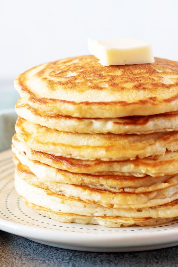 These fluffy American pancakes are pillowy, moist, and buttery.Each pancake is cooked to a perfect golden brown with a crispy, crunchy edge. #pancakes #breakfast #crispyedges #butter