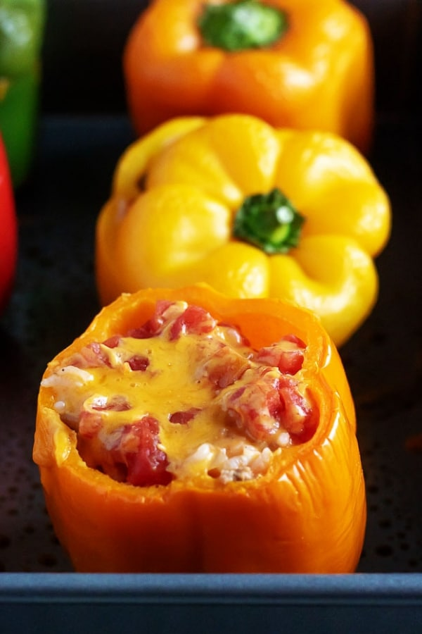 Ground Turkey Stuffed Peppers are a great weeknight dinner option. Full of rice, turkey, tomatoes, and cheese, everyone will ask for seconds! #stuffedpeppers #groundturkey #dinner #berlyskitchen #weeknightdinner