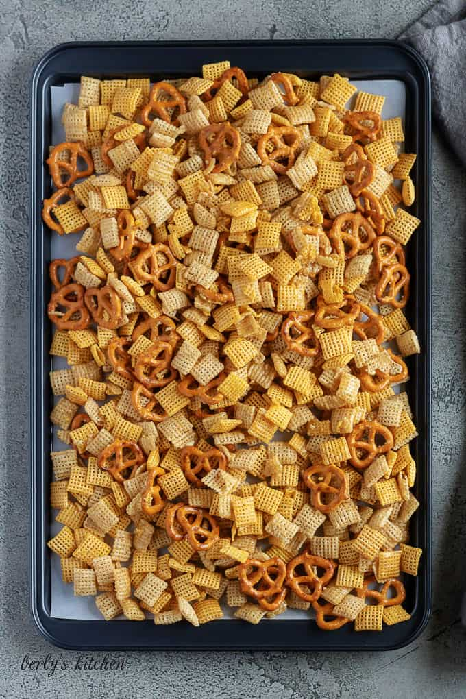 In this picture, the Chex mix and pretzels have been baked to create a sugary coating over the salty ingredients.
