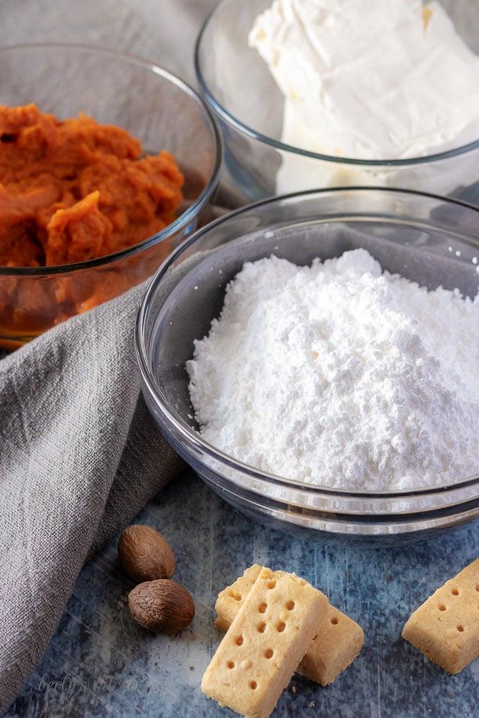 The pumpkin dip ingredients, like canned pumpkin, powdered sugar, and pumpkin pie spice.