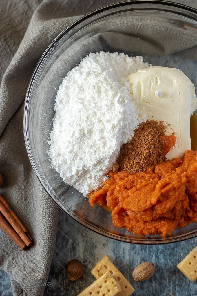 All of the pumpkin dip ingredients in a large mixing bowl, ready to be mixed.
