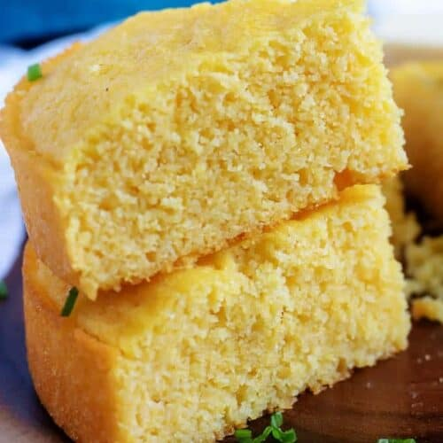 Two pieces of buttermilk cornbread stacked on top of each other.
