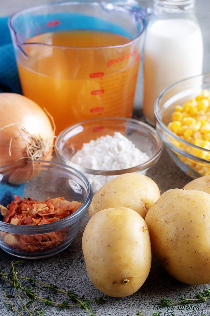 The corn chowder ingredients like potatoes, bacon, and onions.
