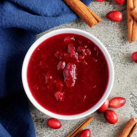 The last photo shows the finished homemade cranberry sauce in a bowl accented with cinnamon sticks.