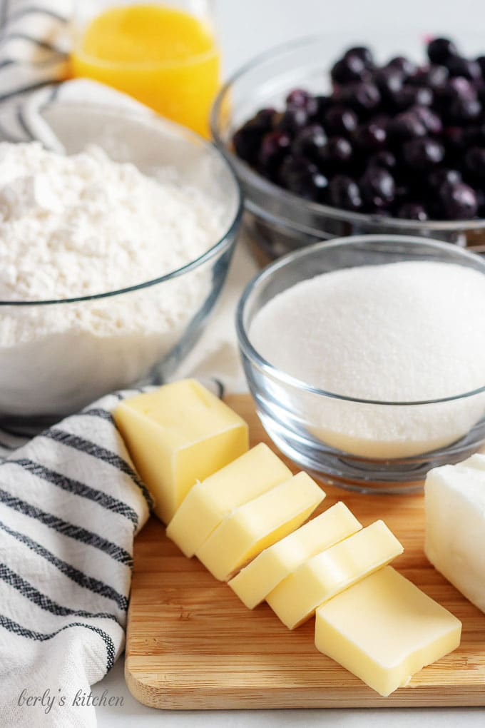 The blueberry pie recipe ingredients like flour, sugar, and blueberries.