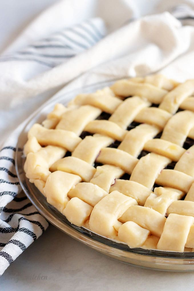 An angled picture of the pie with the lattice crust just before it goes in the oven.