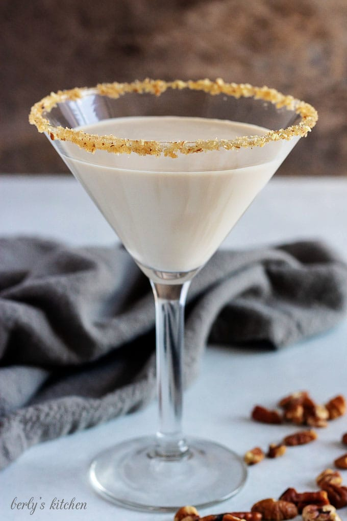 A close-up picture of the pecan pie martini in a long-stem martini glass.