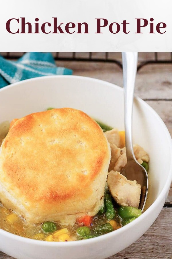 Pinterest image showing the finished chicken pot pie in a white bowl.
