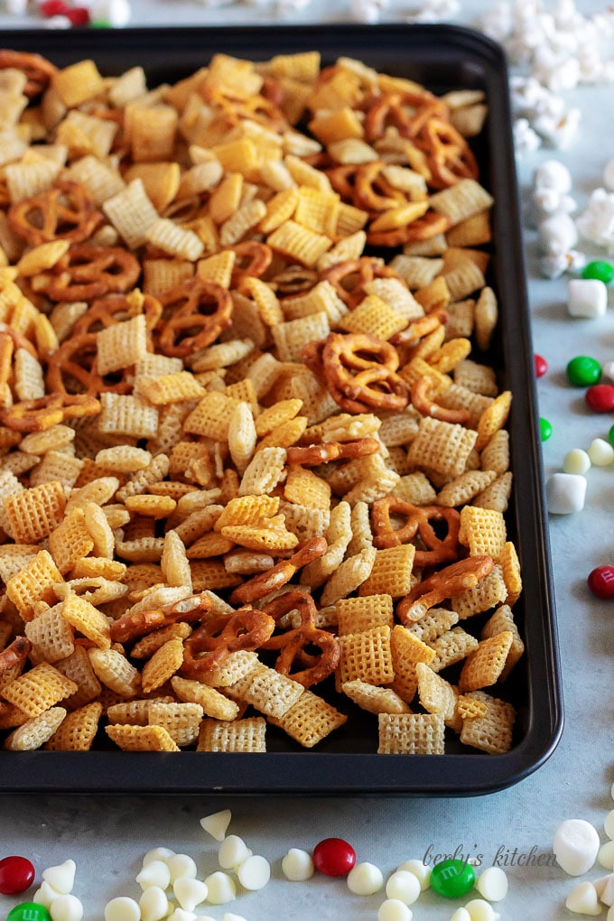Christmas Chex Mix on a baking sheet.