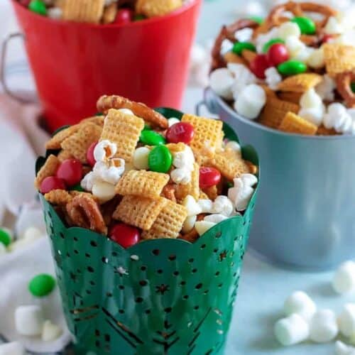 Christmas Chex Mix in three festive tins.