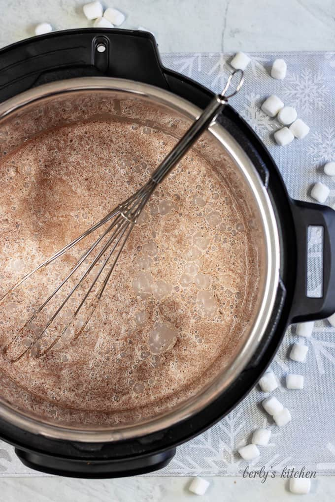 Top down view of Instant Pot Hot Cocoa in the Instant Pot with a whisk.