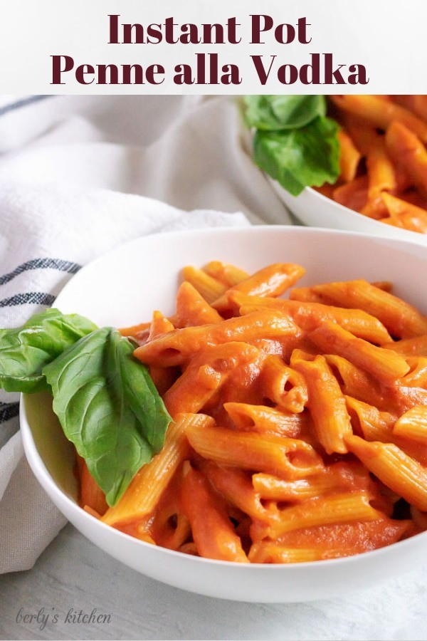 Pinterest photo of two white bowls of penne alla vodka.