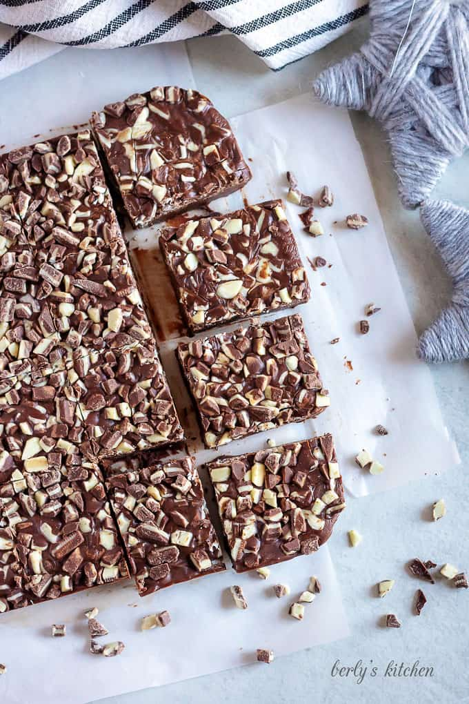 The fudge has set and has been cut into large squares.