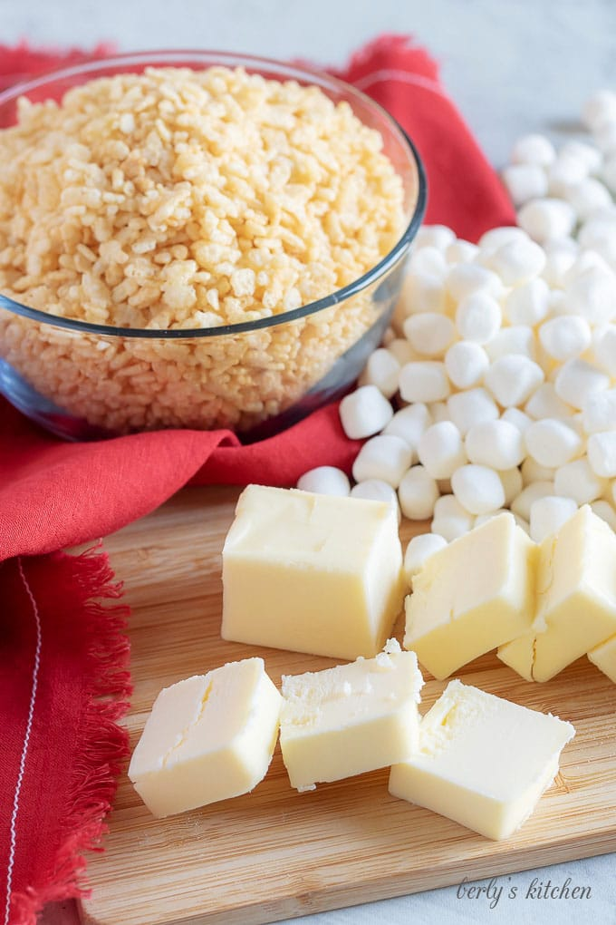 Rice cereal, butter, and marshmallows used for the perfect rice krispie treat recipe.