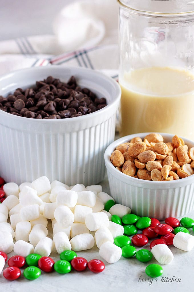 The fudge ingredients, like peanuts, chocolate chips, marshmallows, and sweetened condensed milk.