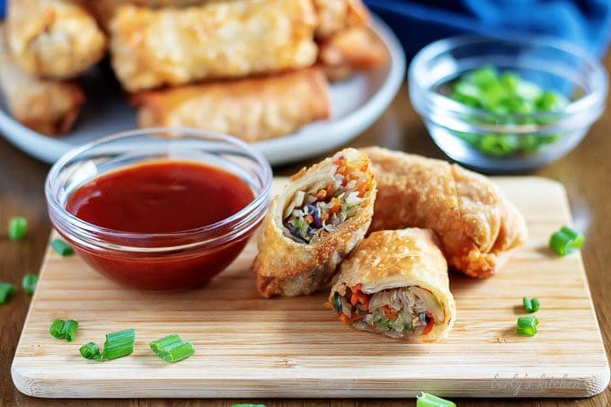 The golden brown egg rolls, served with sweet and sour sauce.