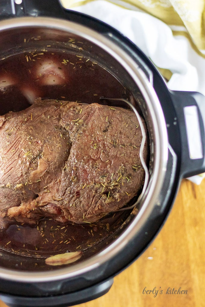 An aerial view of the finished pot roast in the pressure cooker.