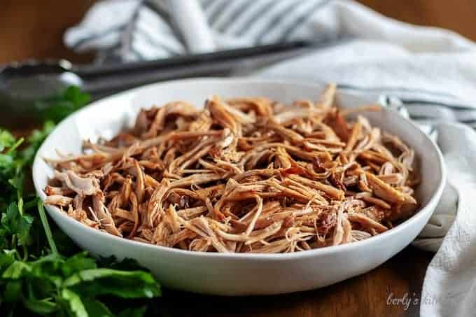 A small serving dish filled with the instant pot pulled pork.