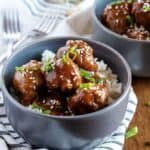 Instant Pot Teriyaki Meatballs with rice in two gray bowls.