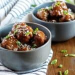 Two bowls of Instant Pot Teriyaki Meatballs with rice.