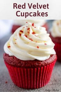 The red velvet cupcake, in a red liner, with cream cheese frosting.