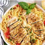Overhead photo of the bruschetta chicken pasta, served with fresh basil.