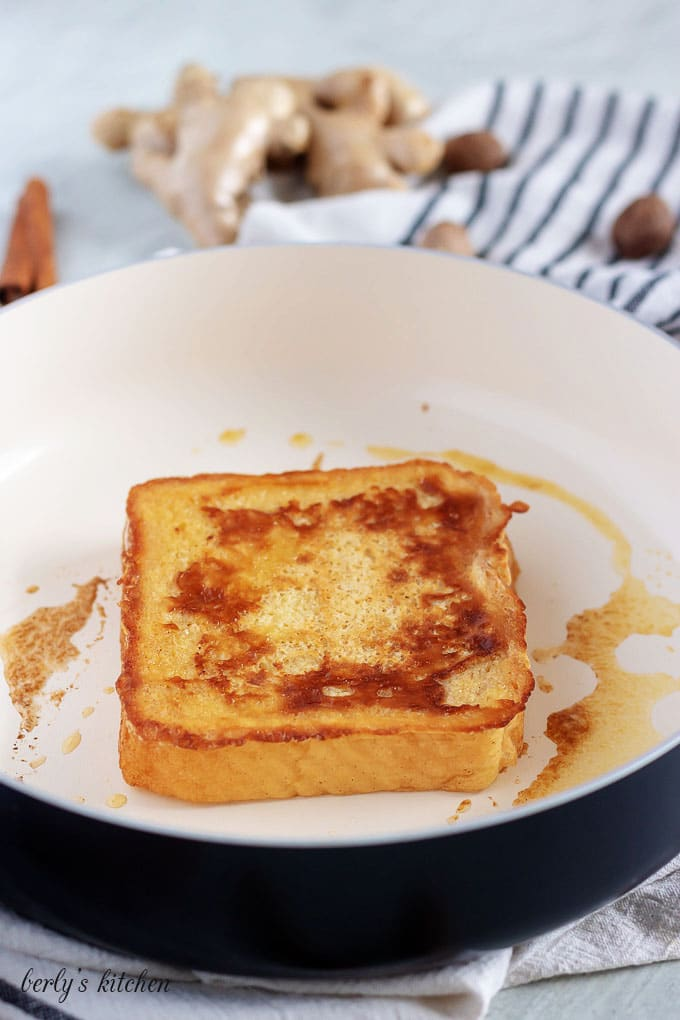Cinnamon French Toast being cooked in a skillet.