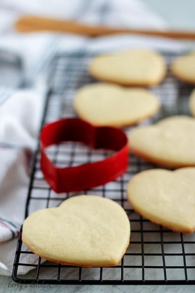 Baked cut out sugar cookies on a cooling rack.