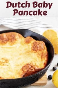 A Dutch baby pancake, fresh from the oven, sitting in a skillet.