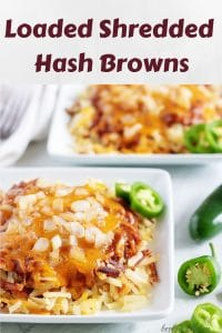 Two bowls of loaded shredded hash browns topped with cheese and onions.