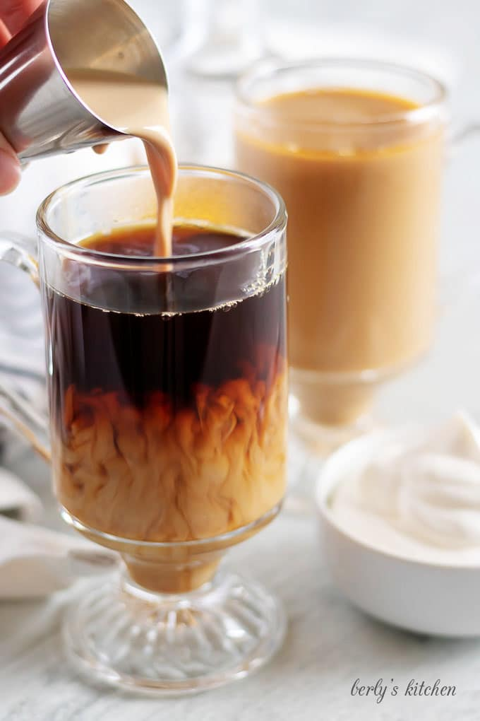 The Irish Cream and Hazelnut liqueurs being combined with the coffee.