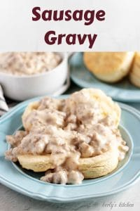 A large photo of the sausage gravy covering two homemade biscuits.