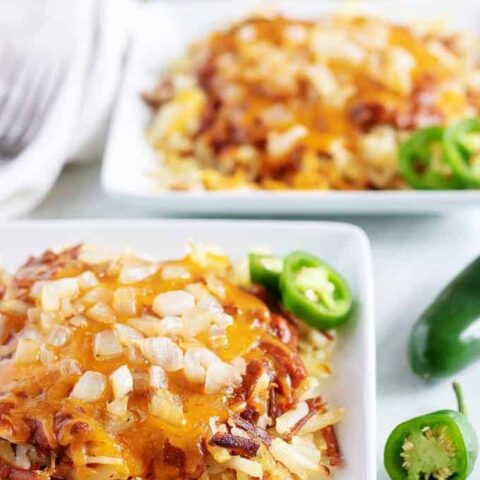 Large photo of the hash browns, smothered in chili and shredded cheese.