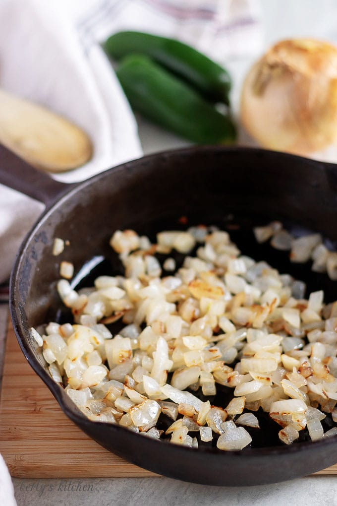 Another photo of the cast iron skillet with saute'd, diced, white onions.