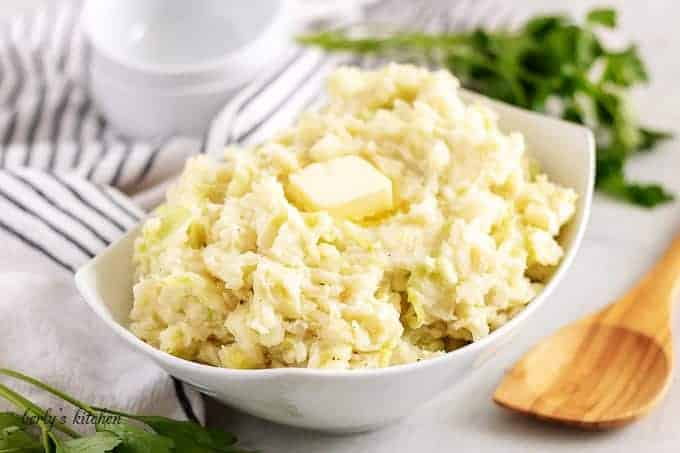 The finished colcannon recipe, in a bowl, topped with butter.