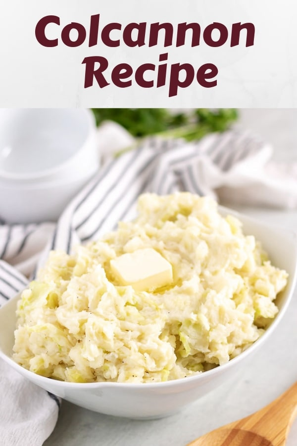 The finished colcannon recipe, served in a bowl, topped with butter.