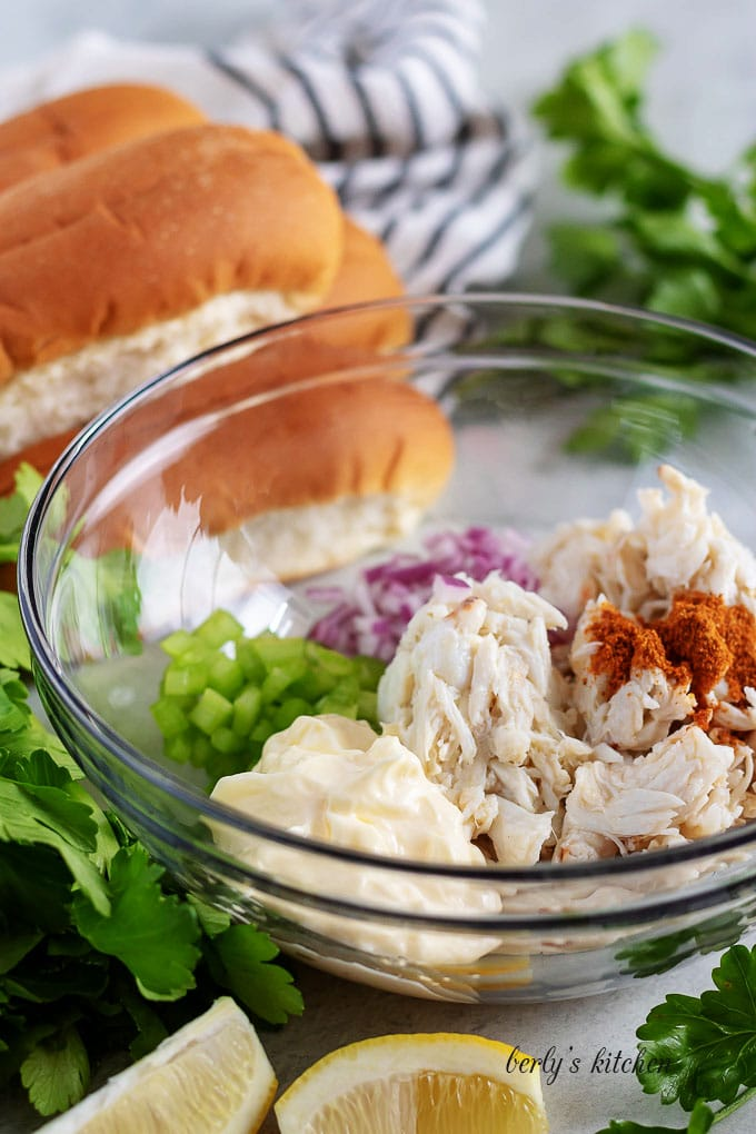 All of the crab roll ingredients placed into a large mixing bowl.