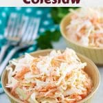 Two small bowls of creamy coleslaw with forks sitting nearby.
