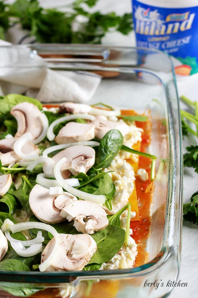 Sliced mushrooms, spinach, and onions, layered over cottage cheese filling.