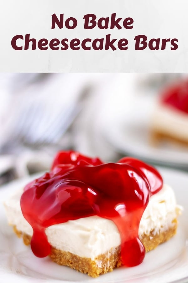 A cheesecake bar, sitting on a white plate, covered in cherry topping.