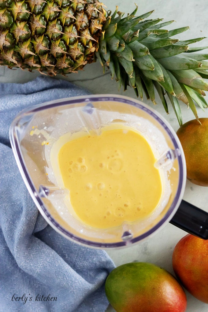An aerial view of the pineapple mango smoothie in the blender.