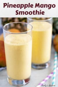 A large photo showcasing two pineapple mango smoothies surrounded by fruit.