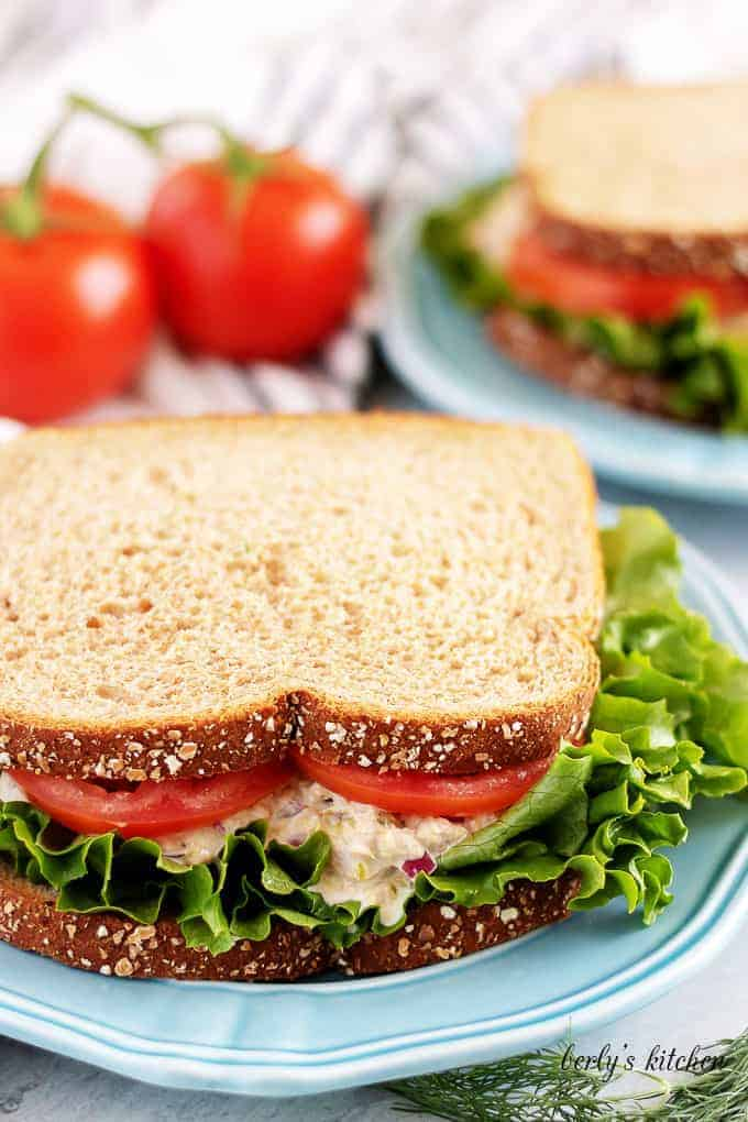 The finished sandwich, on whole wheat bread, with lettuce and tomato.