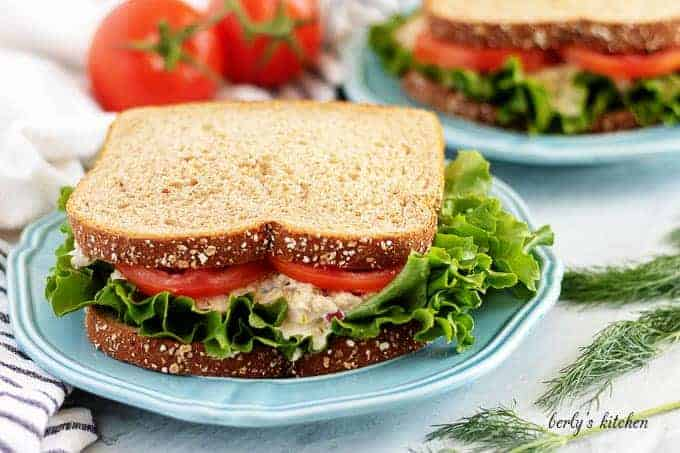 The tuna salad sandwich served on wheat bread with lettuce and tomato.