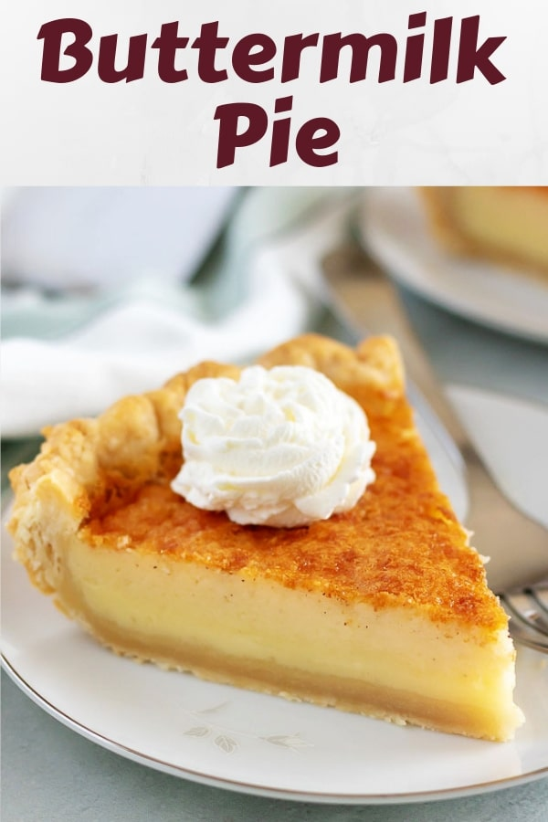 A large slice of buttermilk pie topped with whipped cream.
