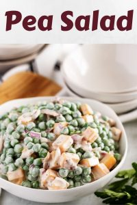 Large photo of the pea salad topped with bacon and cheese.