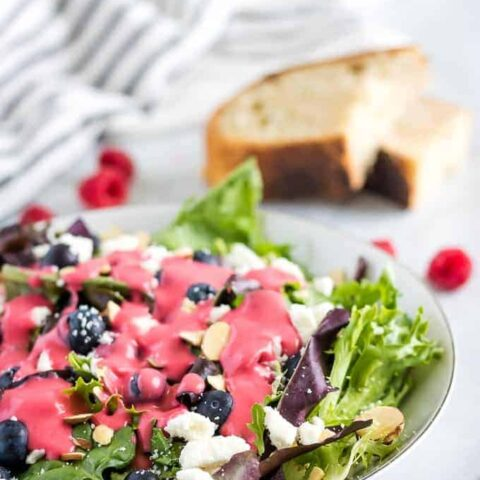 Raspberry vinaigrette over a of Spring mix topped with feta cheese.