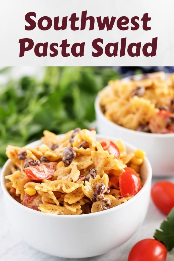Two bowls of Southwest pasta salad garnished with fresh grape tomatoes.