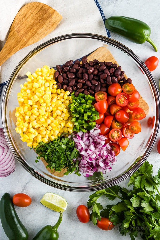 An aerial view of the corn and other ingredients in a bowl.