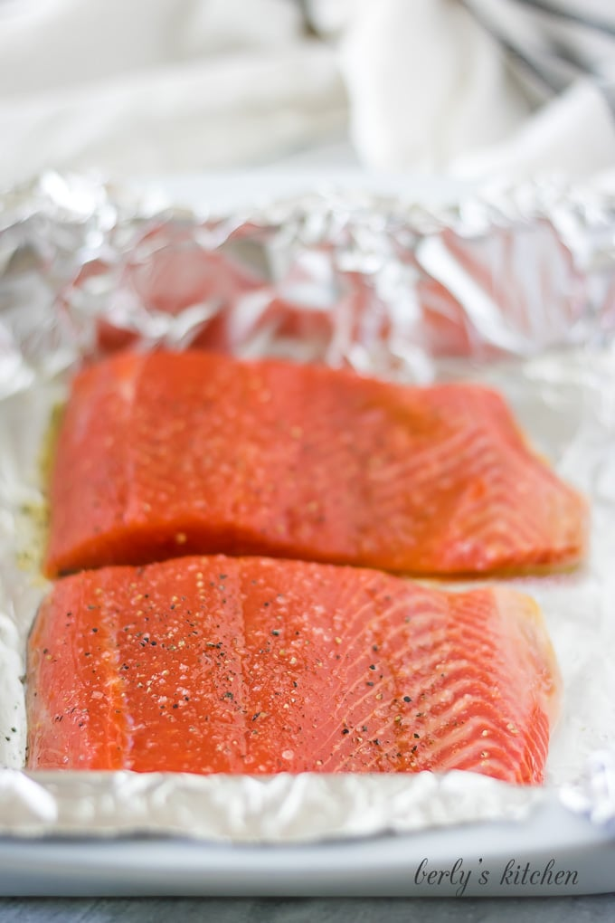 We've topped the salmon with olive oil, salt, and pepper.